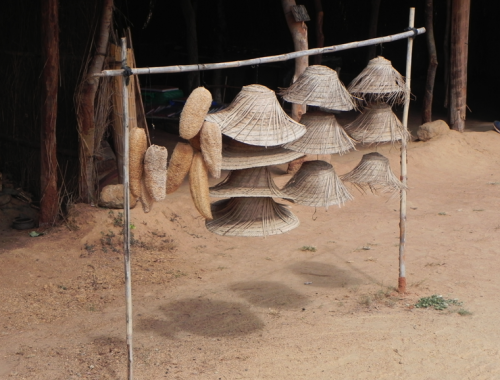 Straw hats for sale in Senga Bay
