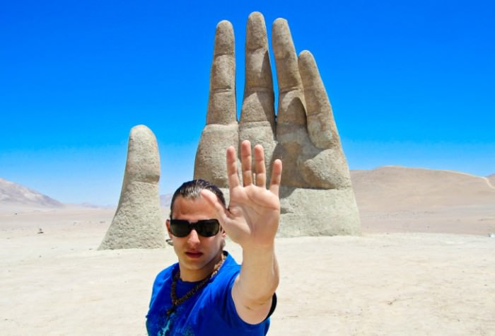 Marcello-Arrambide-at-the-hand-in-the-sand-Chile-728x494