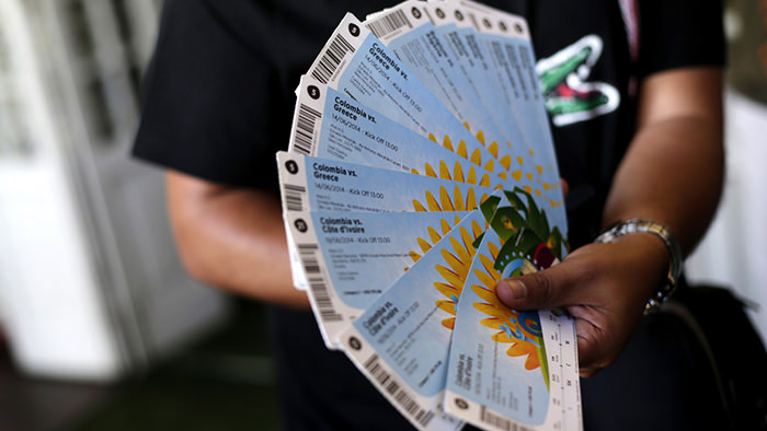 A Colombian fan displays his FIFA 2014 World Cup tickets in Rio de Janeiro